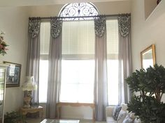 Beautiful custom draperies 20 feet in the air with a silver tableaux Arch  installed yesterday in this beautiful Grand home formal living room in Rowlett. Contact me at Blinds and Drapes for Less  972 270 323