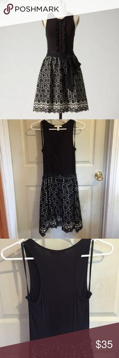 """Anthropologie Annular Dress By Weston Wear. Rayon/spandex top; cotton/nylon skirt (which is lined). Buttons down to the skirt; racerback; hidden side pockets; string belt loops. The belt is missing, though any black sash matches and other colored belts look good as well. The top shows fuzzing from being loved and from the nature of the fabric. Bust is about 15"""" flat (stretches some); waist is about 12.5"""" flat and is elastic; length is about 37"""". Anthropologie Dresses"""