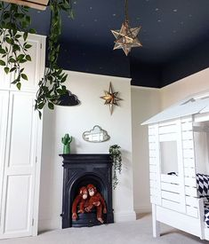 has given her child's room a spectacular makeover! The dark ceiling covered in beautiful little gold stars is the perfect touch for this room and the star pendent light finishes it off! We love the contrast between the dark and light paint! Dark Ceiling, Colored Ceiling, Stars On Ceiling, Ceiling Panels, Star Bedroom, Home Bedroom, Bedrooms, Bedroom Ceiling, Ceiling Decor