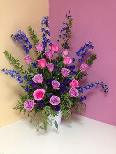 Blue delphinium, Lavender roses, purple status and pink roses make the perfect altar arrangement for a church wedding. #purple weddings #weddings #Rangers Floral Garden #church altar flowers