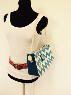 upcycled handbag with blue layflat hoses and blue chevron pattern
