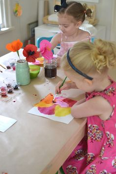 4-year olds painting flowers in the style of Georgia O'Keefe
