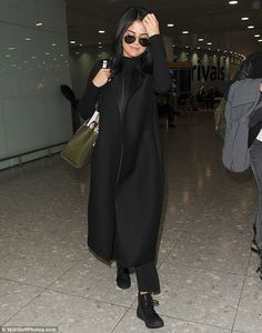 The pop starlet went for an extremely low-key look in baggy black trousers with a roll-neck jumper and a long coat Selena Gomez Outfits, Roll Neck Jumpers, Black Trousers, Low Key, Duster Coat, Normcore, London, Jackets, Cold