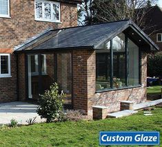 A beautiful Custom Glaze garden room extension that has become an integral part of the home, giving the customer a large lounge area in the kitchen/dinning room. Beautiful, tall, gable end windows allow undisturbed views of the garden. A bi-fold door and Conservatory Ideas Sunroom, Modern Conservatory, Conservatory Kitchen, Conservatory Interiors, Orangerie Extension, Conservatory Extension, Orangery Extension Kitchen, House Extension Plans, House Extension Design
