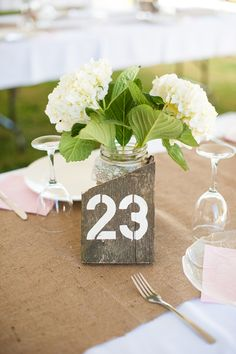 Tanis Katie Photography // www.taniskatie.com // beige and pink wedding // Outdoor wedding // wooden table numbers // burlap table runners // green and white wedding flowers // DIY wedding //