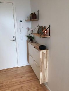 A sleek entryway console of an IKEA Trones item with a plywood waterfall countertop to give it a more stylish look. A sleek entryway console of an IKEA Trones item with a plywood waterfall countertop to give it a more stylish look. Entryway Console, Entryway Storage, Entryway Decor, Entryway Ideas, Shoe Storage Ikea Hack, Ikea Shoe, Hallway Ideas, Ikea Interior, Interior Ideas