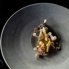 Scallops from Trondheim grilled over burning embers & winter apples. One of the many gorgeous dishes from the three michelin starred restaurant Maaemo (@maaemo) in Oslo Norway. Congratulations on achieving your third well deserved star @esbenhb! #gastroart by gastroart