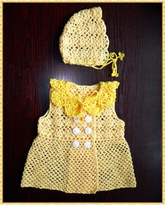 Yellow crochet dress with a collar and cap.