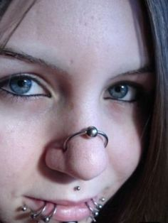 double nose piercing with a hoop thing....interesting