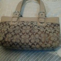 Coach Brown and beige hand bag It does have some ink stains in the inside but the outside is in good condition Coach Bags Totes