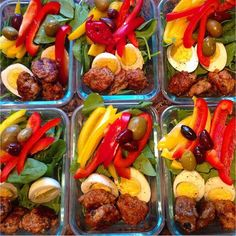 baby spinach beds topped with bell peppers, olives, and meatballs