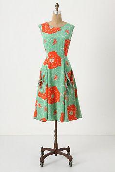 I love the pattern and shape of this dress, but the pockets and the open back make it!