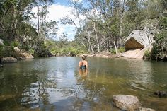 Sand and surf aren't the only stars of summer. Amid the lush green hills, farms and national parks of Southern Queensland Country, are some of the state's most refreshing, secluded and bloody beautiful swimming spots. Escape the holiday frenzy at the local beach and cool off at one of these 10 waterfalls and waterholes! #thisisqueensland