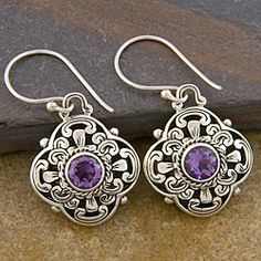 Round amethysts set in silver dangle earrings  Handmade jewelry is the perfect addition to your jewelry collection  Dangle earrings designed and crafted by talented Indonesian artisans