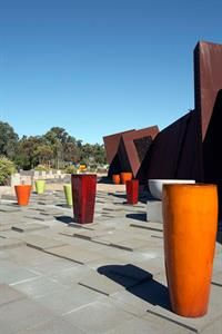 Gallery of Atomic Glazed Pots in various landscapes. Bold Colors, Colours, Garden Pots, Terracotta, Modern Design, Planter Pots, Landscape, Architecture, Gallery