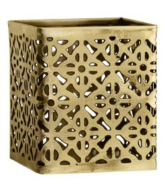 Small tea light holder in metal with a perforated pattern. Size 2 1/4 x 2 1/2 in.