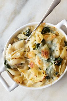 NYT Cooking: Toss spinach-artichoke dip with pasta, and it feels right at home o… – Jennifer Space Giada De Laurentiis, Healthy Panini, Spinach Artichoke Pasta, Baked Artichoke, Spinach Gratin, Risotto, Pasta Recipes, Cooking Recipes, Stuffed Pasta Shells