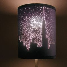 DIY City Skyline Pierced Lampshade Video Tutorial from ThreadBanger here.*If you have questions about the weight of paper there are lots of tutorials around on how to make a paper lampshade.