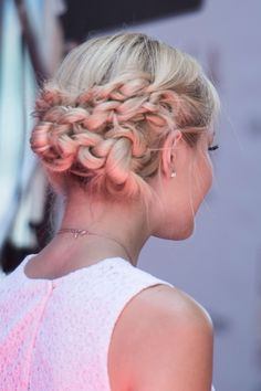 This braided updo that actress and I Didn't Do It star Olivia Holt wore at an Earth to Echo screening over the weekend is so stunning, you might need a second to recover after you see its full glory. Created by hairstylist Corina Kramer, it was a an oblong coil of braids that went from one ear to the other across the back of her head. And though it's hard to tell for sure, it looks like it was done with three plaits: two thinner ones at the top starting on either side and one thick one that…