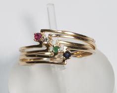 Conjunto 4 anéis em diamante, rubi,safira,esmeralda