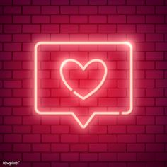Neon light Valentine's day symbol on brick wall | free image by rawpixel.com / NingZk V.