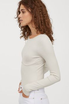 Fitted thong bodysuit in ribbed jersey with a slight sheen. Long sleeves, seam below bust, and snap fasteners at gusset. Spring Fashion, Winter Fashion, Trending Art, Ballet Fashion, Minimalist Wardrobe, Light Beige, Fashion Company, Fitness Fashion, Personal Style