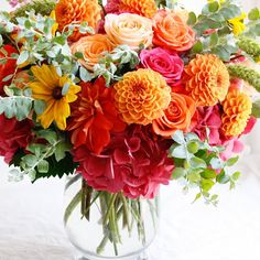 Friday favorite in oranges, yellows, and hot pinks!  Nothing says summer like dahlias, hydrangea, and roses. | LILLA BELLO