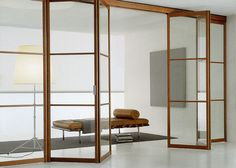 doors provide an operational solution that transforms a room into a more. -Sliding doors provide an operational solution that transforms a room into a more. Glass Partition Wall, Sliding Door Systems, Interior Architecture, Interior Design, Folding Doors, Internal Doors, Deco Design, Exterior Doors, My New Room