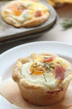 "Eggs, ham and cheese get nestled into savory little Bisquick muffin cups in this simple, on-the-go breakfast. They'll keep in the freezer, too—just wrap them individually with plastic wrap and keep frozen up to 1 month. Betty member HockeyMom42 says, ""Great recipe—so easy for the kids to grab and go before school."""