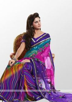 Enhance your beauty wearing this beautiful multicolor saree. Colorful printed skirt portion with net pallu gives it designer look and makes it perfect selection for semi-formal parties. http://goodbells.com/saree/beautiful-purple-saree.html