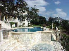 Pool on hillside, stone surround