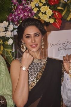 Nargis Fakhri attended the launch of Titan Raga's 'Garden of Eden Collection' at the Tanishq showroom in Andheri, Mumbai, on Monday. America's Next Top Model, Wire Wrapped Earrings, Queen Of Hearts, Indian Outfits, Indian Jewelry, Beautiful People, Bollywood, Product Launch, Hairstyle