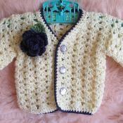 Easy Baby Sweater Crochet Pattern - via @Craftsy