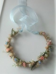 Floral crown for flower girls - see more ideas on http://themerrybride.org/2014/04/05/peach-yellow-and-light-blue-wedding/