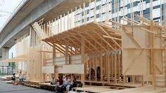 Two hundred Swiss architecture students have designed and built this events pavilion in Zurich, using lengths of timber to create a towering staircase