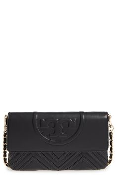 Obsessing over this must-have clutch by Tory Burch that easily converts to a crossbody with its chain-and-leather strap.