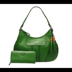 Etienne Aigner Hobo Handbag Wallet Kelly Green EUC Mint condition, hardly used. Vibrant green color with bamboo zipper pulls, leather tassels, contrasting satin lining and matching wallet. Nice roomy hobo handbag Etienne Aigner Bags Hobos