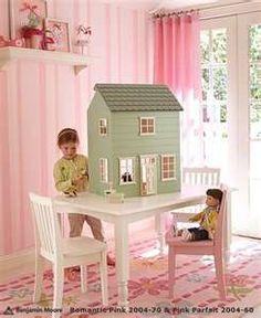 cute dollhouse in girl's room