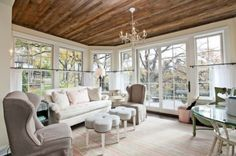 I love the contrast in this sunroom. The soft colors and feminine style combined with the raw rustic wood ceiling is a beautiful combination.