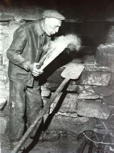 The baker blows on the bread, Moulin de Counil, Corrèze, photo Jean Gabriel Marquis, c. 1960