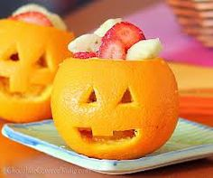 filled with fruit.   jack o'lantern made from oranges - Google Search