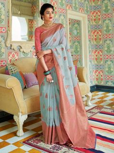 """Pale Blue And Pink Handloom Silk Traditional Saree,crafted with zari thread work enhancing the embroidered patterns on the saree. Comes with matching blouse. This product will be as shown in semi-stitched material. For stitching to size select using our tailoring options """" customised """".Stitching to specific sizing will be subject to design limitations. This will fit bust and waist sizes 32,34,36,38,40,42 (UK sizes 6-16) . Top length 14-15″ max. Slight variation in colour & embroidery work… Designer Silk Sarees, Designer Sarees Online, Anarkali, Lehenga, Turquoise Blue Color, Raw Silk Saree, Jamdani Saree, Ethnic Wear Designer, Casual Saree"""