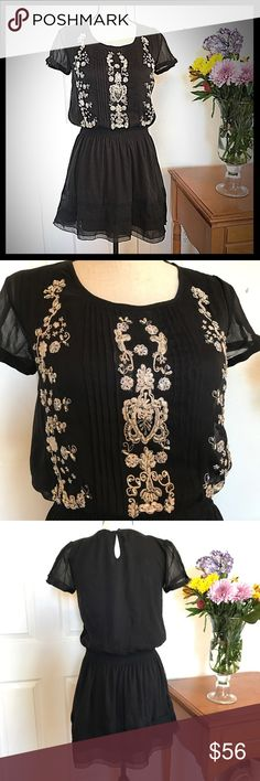 Yumi Dress Black Embroidered Cute! Yumi dress size 6. Bust 17.5 inches laying flat not doubled and is 33 inches long. Black with Embroidered front and elastic waistband. Excellent condition Yumi Kim Dresses Mini