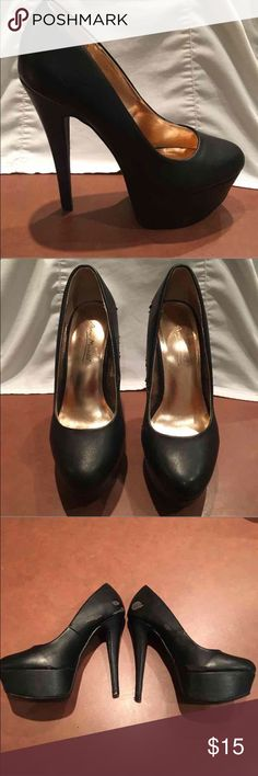 Black high platform pumps size 7 Very high heel black pumps 5 1/2 inch heel and 2 inch platform. Size 7 Brand: Anne Michelle Very worn & scuffed instep/outer arch as pictured however bottoms in good condition.  Perfect with any little black dress! Shoes Platforms