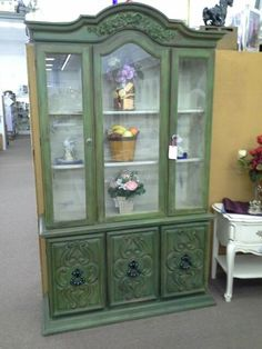 $289 - This shabby chic china hutch is painted green with rose bouquet applique over the center, then distressed to give it a Rustic Shabby Look. ***** In Booth H13 at Main Street Antique Mall 7260 E Main St (east of Power RD on MAIN STREET) Mesa Az 85207 **** Open 7 days a week 10:00AM-5:30PM **** Call for more information 480 924 1122 **** We Accept cash, debit, VISA, Mastercard, Discover or American Express