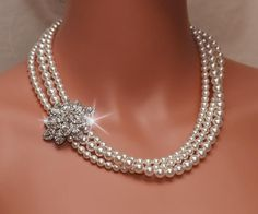 ARIANA Collection Rhinestone and Swarovski Pearl Bridal Necklace Gorgeous Handmade Necklace with stunning rhinestone centerpiece and white Swarovski pearls Rhinestone centerpiece measures about 1.5 x