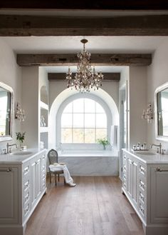 wood beams, wood floor, chandeleir, window near tub