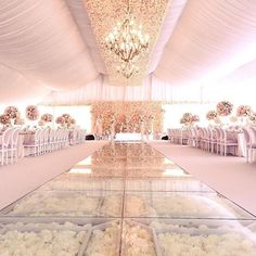 A GLASS FLOOR filled with 60,000 ivory blooms added an element of unexpected modernity | design created by Kaman Or from Only Mine | Wedluxe Magazine |