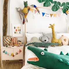 home accessories decor, home accessories ideas Animal safari children's decor on Ikea bed frame with monstera leaf garland - crafte. Bedroom Themes, Kids Bedroom, Ikea Bed Frames, Cama Ikea, Casa Kids, Art Wall Kids, Wall Art, Cool Beds, Kids Decor