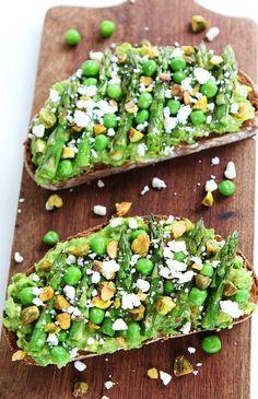 Avocado Asparagus Toast Recipe on twopeasandtheirpod.com Avocado toast with asparagus, peas, pistachios, and feta cheese. This simple spring toast makes a great appetizer, snack, or meal!